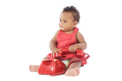 Baby with red phone Royalty Free Stock Image