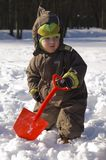Baby with red shovel Royalty Free Stock Images
