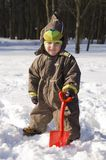 Baby with red shovel Stock Photo