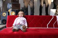 Baby on red sofa Stock Photos