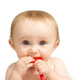 Baby with a red spoon Stock Image