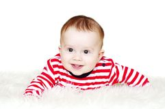 Baby in red striped t-shirt on white background. Lovely baby in red striped t-shirt on white background stock image