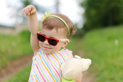 Baby in Red Sunglasses Stock Photo