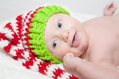 Baby in Red White and Green Knit Hat Stock Images