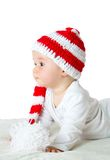 Baby in red white knitted hat Stock Photos