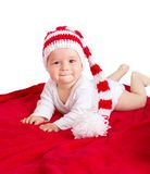 Baby in red white knitted hat Stock Image