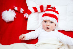 Baby in red white knitted hat stock photo