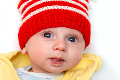 Baby with red winter hat Royalty Free Stock Images