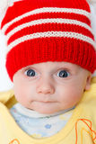 Baby with red winter hat Royalty Free Stock Photo