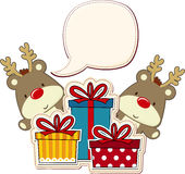 Baby reindeer and gift boxes Stock Photo