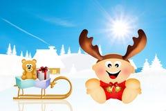 Baby with reindeer horns Stock Photo