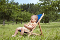 Baby relaxing in garden Royalty Free Stock Images