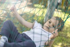 Baby relaxing in the hammock Stock Image
