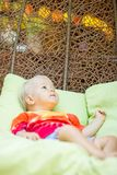 Baby relaxing Stock Images