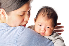 Baby rely on mother's arm Stock Photo