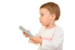 Baby with remote control Royalty Free Stock Images