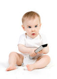 Baby with remote control Stock Photos