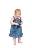 Baby with remote control Stock Image