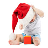 Baby removes his Christmas Hats Stock Photo