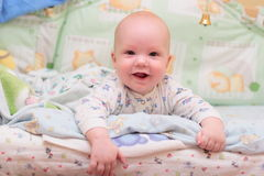 Baby rest on bed. And look at camera #2 Stock Photography