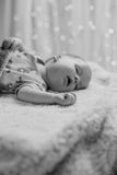Baby resting with mouth open. Picture of cute baby resting with mouth open Royalty Free Stock Images