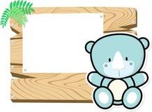 Baby rhino on wooden board Stock Photo