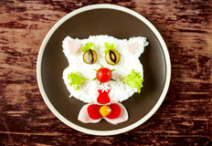 Baby rice dish in the form of a cat. Stock Image