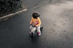 Baby riding bike Stock Images