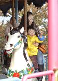 Baby riding merry go round Royalty Free Stock Photos