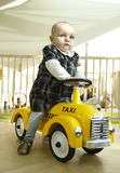 Baby Riding Toy Car Royalty Free Stock Photography