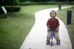 Baby riding tricycle Royalty Free Stock Photo