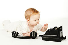 Baby ringing up Stock Photos
