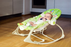 Baby in the rocking chair Stock Photos