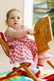 Baby on rocking horse Royalty Free Stock Images