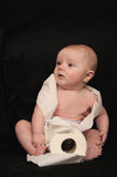 Baby with roll of toilet paper Royalty Free Stock Photos