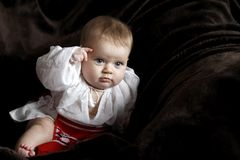 Baby in Romanian clothes. Cute baby girl in traditional Romanian folk costume or clothes Stock Photography