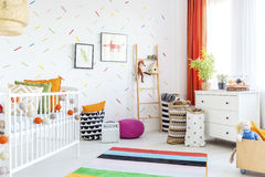 Baby room with dresser. Baby room with white dresser, cot and carpet Royalty Free Stock Image