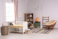 Baby room interior with comfortable crib. And papasan chair Stock Image