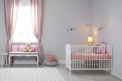 Baby room interior with comfortable crib. And indoor bench Stock Images