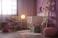 Baby room interior with crib. Near color wall stock image