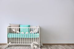 Baby room interior with crib wall. Baby room interior with crib near wall royalty free stock photography