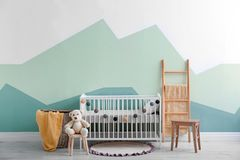 Baby room interior with crib   wall. Baby room interior with crib near wall Stock Images