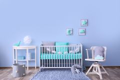 Baby room interior with crib. Near wall Royalty Free Stock Photo