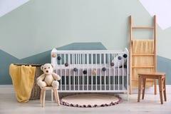 Baby room interior with crib. Near wall Stock Photos