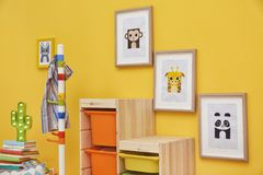 Baby room with pictures of animals. On wall Royalty Free Stock Photo
