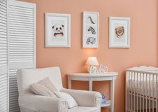 Baby room with pictures of animals. On wall Royalty Free Stock Photos