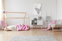 Baby room with poster. Cozy baby girl room with positive poster of a butterfly on the wall royalty free stock images