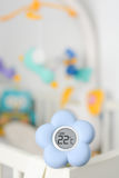 Baby room temperature monitor. Flower shaped baby room temperature monitor Royalty Free Stock Photo