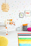 Baby room with wall decor. Baby room with colorful wall decor and white cot Royalty Free Stock Photo