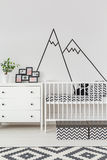 Baby room with wall decoration. Baby room interior with cot and wall decoration Royalty Free Stock Photography